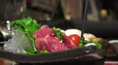 Stock Video Footage of Chopsticks Pick Up An Sashimi (Most Likely Horse Meat) 4K