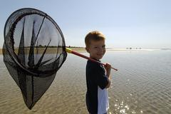 Children searching animals at the lagoon at the adria near bibione italy Stock Photos