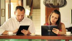 Young couple with tablet computers in kitchen at home HD Stock Footage