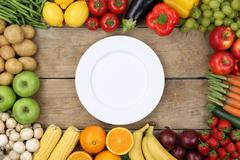 vegetables and fruits with empty plate - stock photo