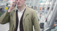 Making an important call before the flight Stock Footage