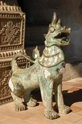 bronze dragon statue temple museum of art and antiquities haw pha kaew museum - stock photo