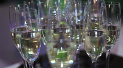 Standing at desk with champagne glasses Stock Footage