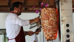 Chef slicing Turkish doner kebab Stock Footage