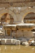 Head of a medusa between arches new forum leptis magna libya Stock Photos
