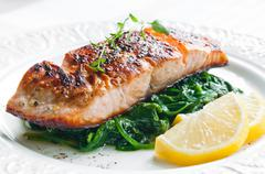 salmon with spinach - stock photo