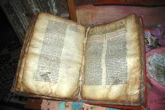 old book of the bible written in amharic script in rock hewn church lalibela  - stock photo