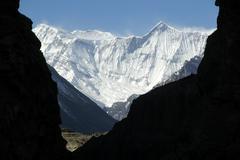 View through a gorge onto ice-capped massive of annapurna ii nar-phu annapurn Stock Photos