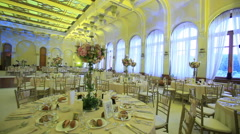 Wedding reception table set awaiting guests and food Stock Footage