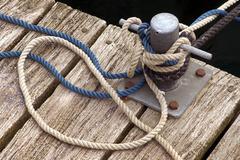 Mooring lines holding a sailboat, duesternbrook marina, kiel, schleswig-holst Stock Photos