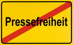 german city limits sign symbolising end of freedom of the press - stock photo