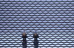 Tiled roof with roof fans Stock Photos