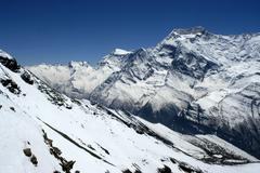 Snow covered high mountains of annapurna ii seen from kang la pass nar-phu an Stock Photos