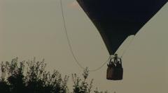 Hot air balloon basket rises through frame Stock Footage