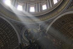 Lightbeams falling through the windows of the dome of saint peter\'s basilica Kuvituskuvat