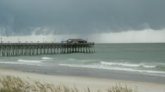 Storm over ocean peir timelapse Stock Footage