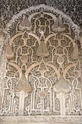 oriental detail of with fine stucco richly decorated mihrab medersa ali ben y - stock photo
