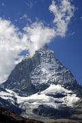 Clouds crowning mount matterhorn, hoernli ridge, zermatt valais switzerland Stock Photos