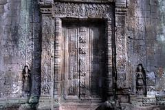Stock Photo of fine decorated disguise door at temple ta prohm siem reap cambodia