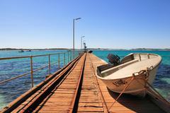 Stock Photo of fisher bot and boardwalk, kangaroo island, south australia. australia