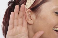 Woman listening Stock Photos