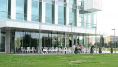 Restaurant with people - exterior - in front of modern building Stock Footage