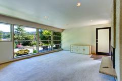empty house interior. glass wall living room - stock photo
