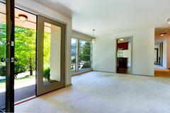 empty house interior. living room with door to backyard - stock photo