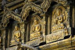Three images of buddha in gold golden temple patan kathmandu nepal Stock Photos