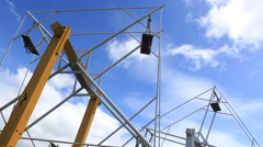 Blank DIY wooden ferris wheel spin over the blue sky with the cloud Stock Footage