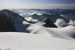 View from mont pelvoux 3.946 m at cottian alps with monviso, provence-alpes-c Stock Photos