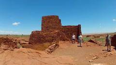 Tourists Explore Wukoki Pueblo In Wupatki National Monument Stock Footage