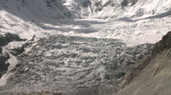 Large glacier, heavily crevassed, tumbles down Andean mountain Stock Footage