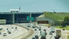 Interstate 285 Traffic Underneath Atlanta Airport Runway Stock Footage