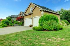 House with two car garage and driveway Stock Photos