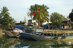 Boats in the harbour of hoi an, vietnam Stock Photos