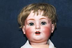 Head of an old doll Stock Photos