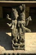 Two carved wooden figures on a roof strut of a house in old town kathmandu ne Stock Photos