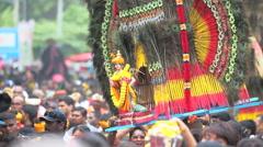 Devotees dancing with Kavadi in crowd at Thaipusam Hindu festival Stock Footage