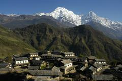 Village in front of the mighty annapurna south massive ghandruk annapurna reg Stock Photos