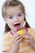 Child with citron Stock Photos