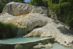 thermal springs and fossa bianca in bagni san filippo, tuscany, italy - stock photo