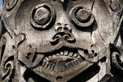 wooden carved face at the museum in kuching sarawak borneo malaysia - stock photo
