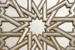 Stock Photo of symmetric pattern star iron portal of mosque hassan ii casablanca morocco