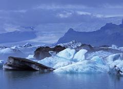 Stock Photo of icebergs in the glacial lake joekulsarlon and in the background the vatnajoek