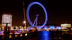 Motion_Timelapse London Eye Night from Whitehall Gardens Promenade 1080 HD Stock Footage