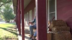 Cowboy rancher playing guitar bunkhouse Stock Footage