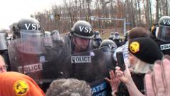 Militerized Police Shove Demontrators and Arrest Daniel Ellsberg Stock Footage