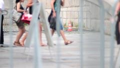 People behind the barrier blurred lens Stock Footage