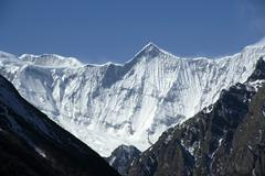 View onto ice-capped massive of annapurna ii and lamjung himal nar-phu annapu Stock Photos